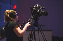 a woman behind a video camera