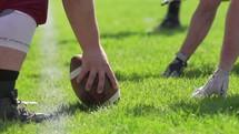football snap at practice