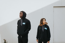 young people in hoodies encouraging other's to vote