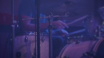 Drummer playing on stage.
