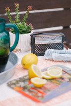 lemons, lemon slices, tablecloth, succulent plant, house plant, table, radio, pitcher, summer, rag, refreshments