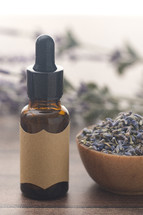 dried lavender and essential oil bottle