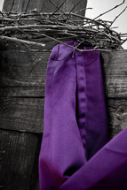 purple cloth on cross
