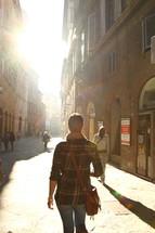 people walking on a narrow Italian street