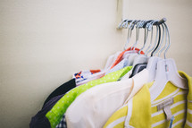 clothes on the rack in a store