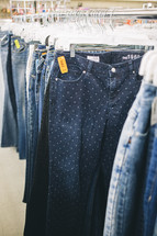 pants and shorts on the rack at a second hand shop