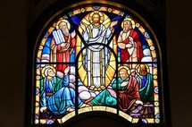 Stained glass window depicting the transfiguration of Jesus between Moses and Elijah