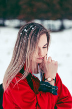 teen girl with snow in her hair