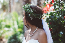 a bride with a crown of flowers in her hair
