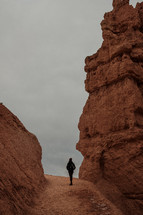 person exploring a red rock canyon