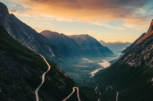 a winding road through mountains and valleys