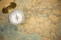 compass on a world map