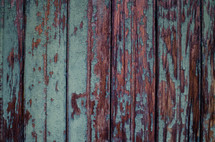 pealing teal paint on weathered wood
