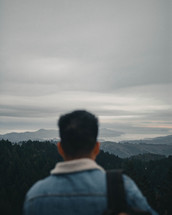 a man looking out over mountains