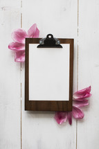 clipboard and flower petals