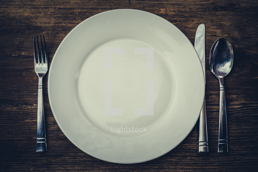 fork, spoon, knife, and plate