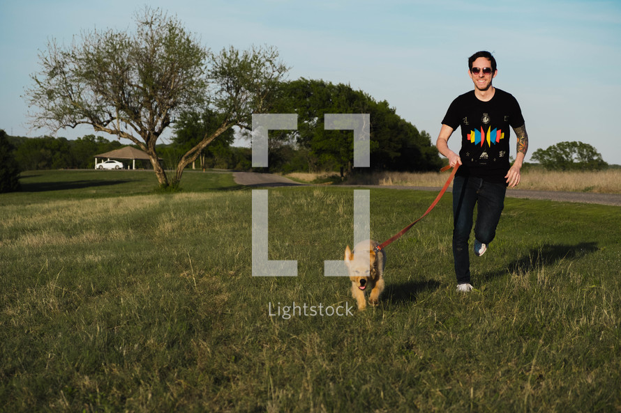 man walking his puppy