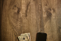 Cell phone next to money