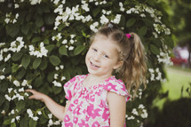 toddler girl with pigtails outdoors in spring