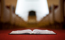 Bible in the aisle of a church