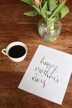 Happy Mother's Day sign, flowers vase, and coffee mug