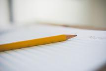 pencil on a spiral notebook