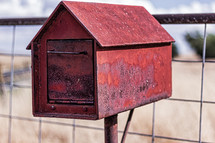 Red metal mailbox