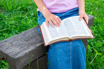 a girl reading a Bible