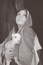 pregnant Mary holding a lamb