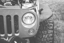 headlights and tires of a Jeep