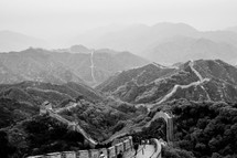 Great Wall of China winding through mountains.