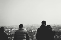 People looking down at a heavy populated city.
