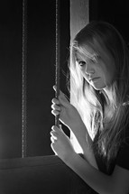 teen girl holding onto bars
