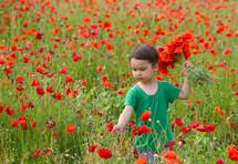 Cute child girl in poppy field. very happy child girl in poppy field. Girl in poppies