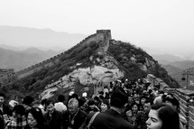 A crowd of people at the Great Wall of China.