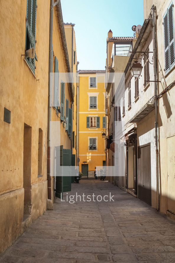 narrow alley between buildings in Europe