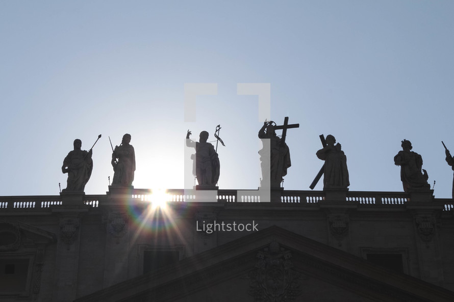 statues on a roof in the vatican in Rome