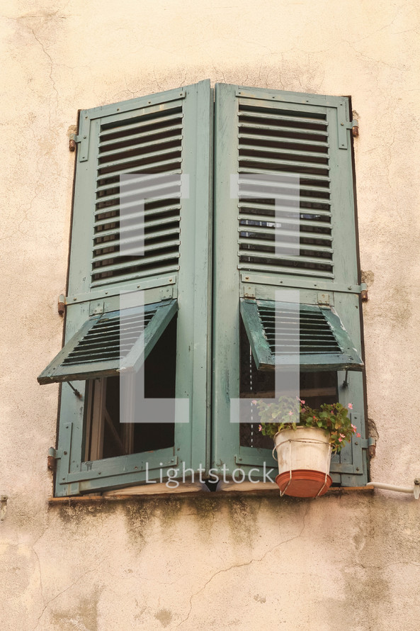 wooden shutters on a window in Italy