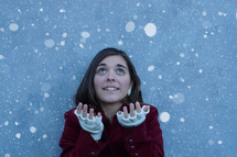 a teen girl catching snow