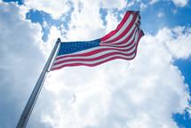 waving American flag on a flagpole