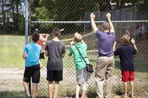 kids watching baseball