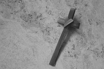 black and white palm frond cross on stone for Palm Sunday
