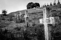 stone cross grave markers on a hill