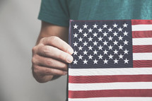 hand holding an American Flag