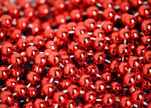 Red beaded glass garland for Christmas tree.