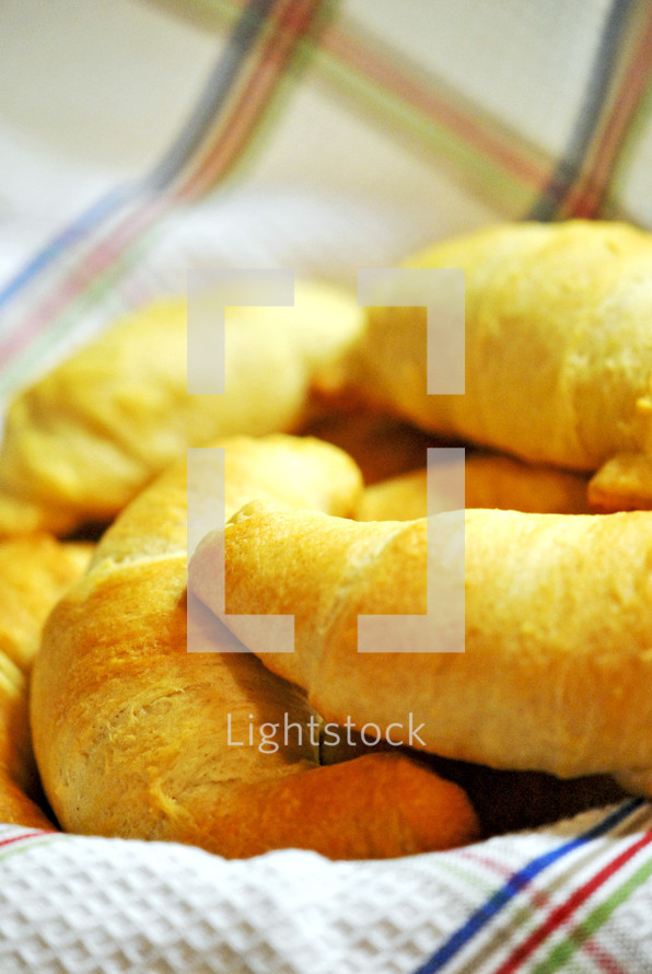 Fresh-baked bread in cloth-lined basket
