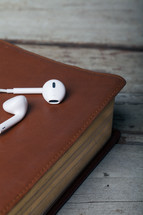 bible and ear buds