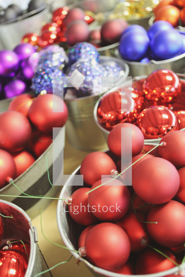 buckets of colourful Christmas ornaments