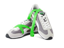Tennis shoes and a tape measure.
