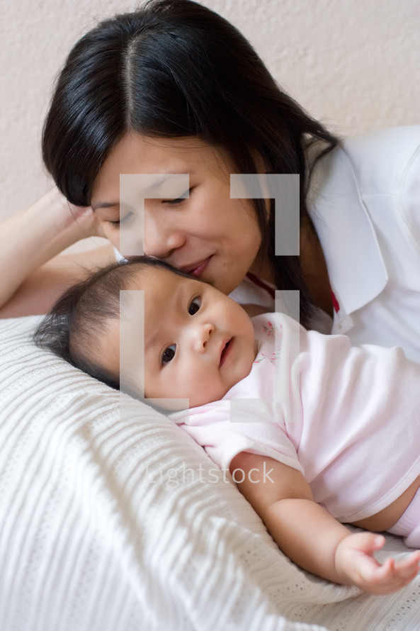 An Asian mother and infant